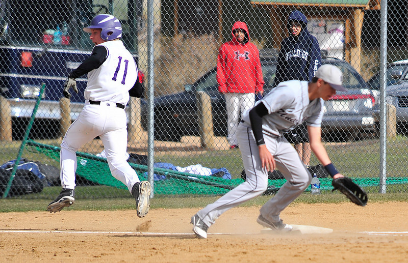 Walt Hester   Trail Gazette<br /> Estes Park's Jonathan Pass was able to turn a single into a triple on a University throwing error. It was part of an explosive 11-run second inning for the Bobcats.