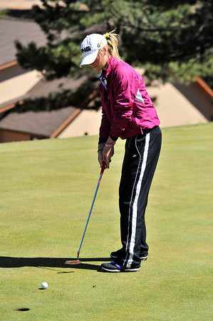 Walt Hester | Trail Gazette<br /> Estes Park's Jesse O'Dell putts for par on the eighth hole on Wednesday. The Estes Park girls collectively set a school record in their only home appearence.