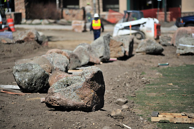 Walt Hester | Trail Gazette Large rocks await placement in Bon Park on Wednesday. The new look of Bond Park is taking shape as work continues.