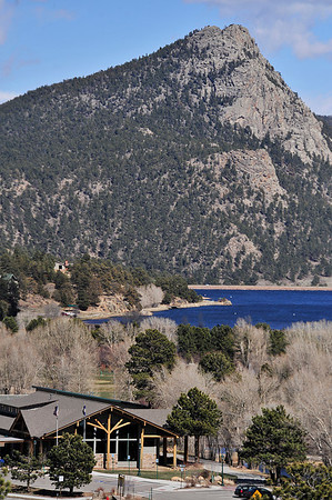 Walt Hester | Trail Gazette<br /> An ice-free Lake Estes reflects the blue of a clear sky on Wednesday. While Estes Park is still awaiting leaves, spring weather arrived at long last on Thursday.
