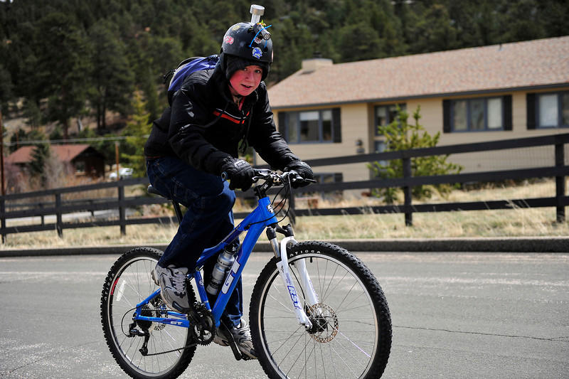 Walt Hester | Trail Gazette<br /> A youngster with a customized helmet grind up Lakeshore Drive on Saturday.