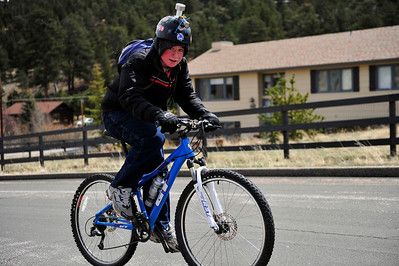 Walt Hester | Trail Gazette A youngster with a customized helmet grind up Lakeshore Drive on Saturday.