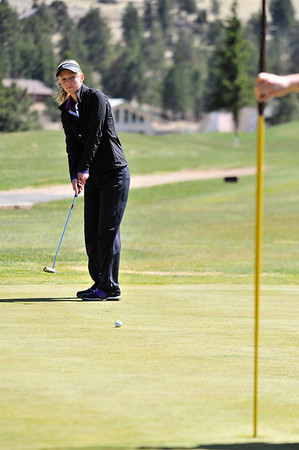 Walt Hester | Trail Gazette<br /> Ladycats' duffer Alli Smith putts on the nineth hole on Wednesday. Her birdie on nine would help the girls score a new school record.