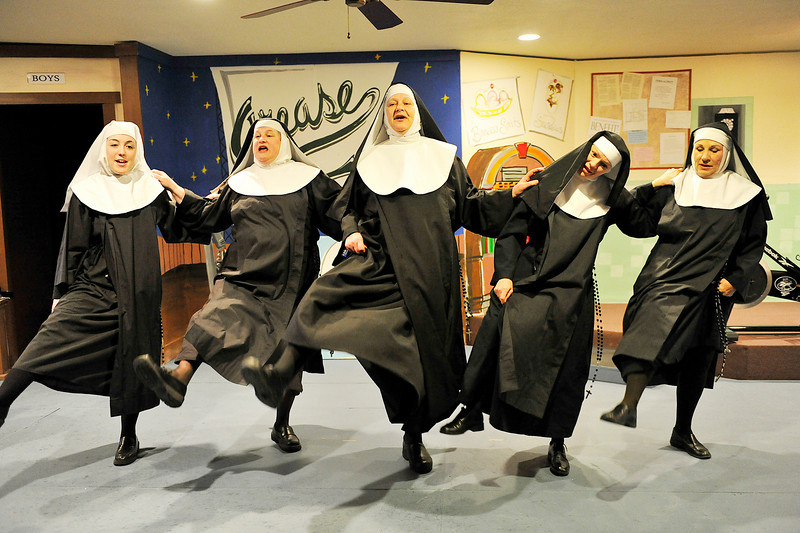 "Walt Hester | Trail Gazette<br /> The Little Sisters of Hoboken kick and sing during Wednesday's rehearsal of Nunsense, which opens at the Peak to Peak American Grille on Friday, and runs over the weekends through Sunday, May 15. The sisters are, from left, Grace Moreau, Carol Blanchard, Catherine ""CJ"" Jensen, Elizabeth Potter and Christann Higley."
