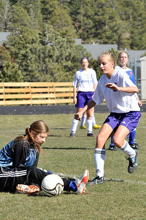 Walt Hester | Trail Gazette<br /> Estes Park's Karin Kingswood cleans up a misplayed ball for the Ladycats' first score against Weld Central on Thursday. The Ladycats beat the visiting Rebels 2-1, keeping the girls in contention for the state playoff bracket.