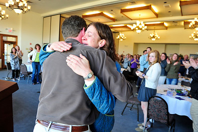 Walt Hester | Trail Gazette James Frank hugs and congratulates Estes Park Middle School teacher Sundee Peisch at the Park R3 Schools staff recognition night at the Lakeshore Lodge on Thursday. Peisch was named the district's Teacher of the Year.