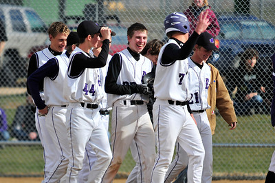 Walt Hester | Trail Gazette Freshman outfielder John Youngbluth, center, enjoys the the praise of teammates on Tuesday after his two-run homer against the visiting University Bulldogs. The dinger was Youngbluth's second of the season.