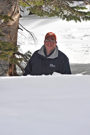 Walt Hester | Trail Gazette<br /> Mike Kavick of Nancy, Ky., stands in a tree well by Bear Lake on Tuesday. The wells are created by the heat of the tree, and in this case, snow drifts and above average snow pack.