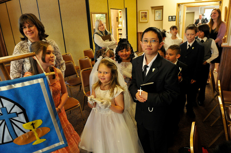 Walt Hester | Trail Gazette<br /> Children wear smiles as well as their Sunday best to their First Communion at Our Lady of the Mountains Catholic Church on Sunday.