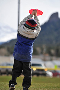 Walt Hester | Trail Gazette Sasha Richmond, 6, of Estes Park can't quite gat a handle on a flying disc at Stanley Park on Tuesday. While the Calendar says May, the weather is stuck in winter, with snow flurries through the first half of the week. Spring should arraive for the weekend, however.