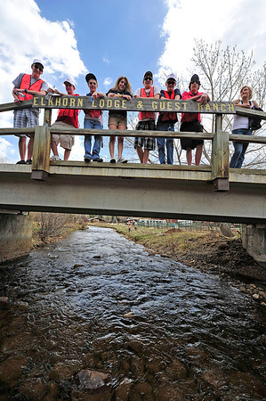 Walt Hester | Trail Gazette<br /> The Estes Park High School's Interact Club awaits the floating flock along the Fall River on Saturday. Plenty of Estes Park volunteers lined the race rout.