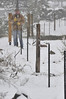 Walt Hester   Trail Gazette<br /> Gary Bien Builds a fence in Wednesday's snow. While snow fell all day, temperatures were warm enough that much melted and compacted.