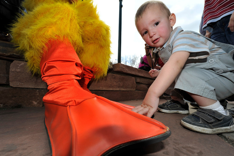 Walt Hester | Trail Gazette<br /> Phoenix Cantu, 18 mo., of Estes Park cant believe the size of Quilton's feet in Riverside Plaza on Saturday. The Duck Race offerd plenty of distractions while waiting for the little ducks to arrive.