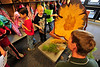 Walt Hester | Trail Gazette<br /> Aidan Donaldson, 6, asks tree-cookie questions of Boyd Lebeda, Colorado State Forester, at the elementary school on Friday. The annual Arbor Day celebration is a little later in Estes Park due to our cooler spring weather.