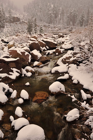 Walt Hester | Trail Gazette<br /> The Roaring River winds its way toward the Fall RIver as snow begins piling up in the national Park on Wednesday. While the rivers and lakes are open, the park is still cold enough to collect more snow then in Estes Park.