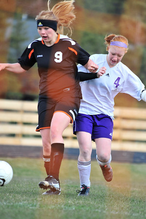 Walt Hester | Trail Gazette<br /> Caroline Miller jostles with a defender earlier in the season. Miller scored against Rocky Mountain Lutheran last week to help solidify the Ladycats' spot in the state playoffs.