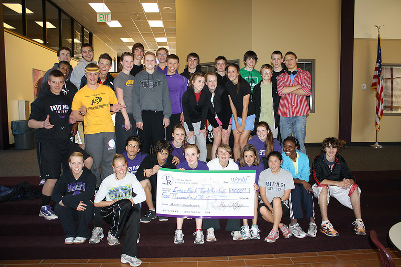 Walt Hester | Trail Gazette<br /> The Estes Park High School track team shows off their $1,000 check from their mattress sale fund raiser they held in April. The Bobcats' football team plans to hold another such fund raiser next fall.