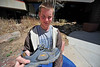 Walt Hester | Trail Gazette<br /> Jesse Shamp shows an example of the 100 pairs of shoes he collected for Africa. The Este Park High-schooler shipped the collection on Tuesday.