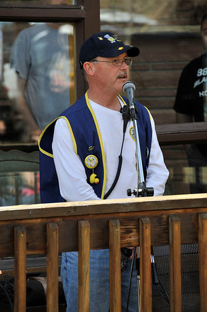 Walt Hester | Trail Gazette<br /> This year's Big Duck, Scott Thompson, acts as MC at the start line of the annual Duck Race. Thompson had the honor of announcing that 5,696 ducks were dropped into the Fall River for the race.