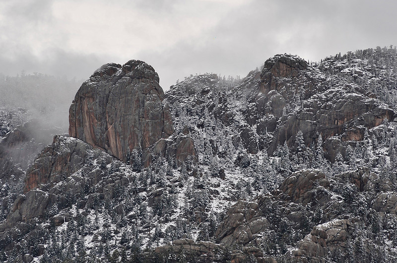 Walt Hester | Trail Gazette<br /> Snow clings to the Twin Owls and Lumpy Ridge as clouds break up over Estes Park on Wednesday. Clouds returned overnight, though sunshine is expected for the weekend.
