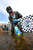 Walt Hester | Trail Gazette<br /> Tom Maher, the traditional catcher of the first duck, does his duty on Saturday. Maher has been on hand for every Estes Park Duck Race, even coming back from his winter home in Arizona to attend.
