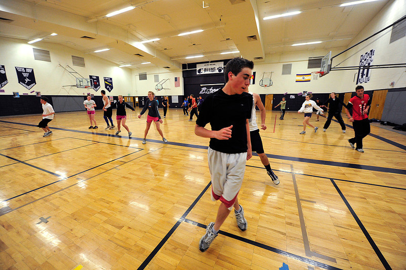 Walt Hester | Trail Gazette<br /> The Estes Park High School track team warms up inside on a snowy Wednesday. The Bobcats' runners heads to Platte Valley for the Patriot League championship on Friday.