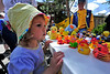 Walt Hester | Trail Gazette<br /> Maelin Rennemeyer, 3, of Windsor scopes out the merchandise at Nicky's before the dropping of the duck. Duck fans were offered plenty of ways to show their enthusiasm at the Duck Race.