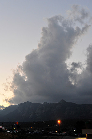 Walt Hester<br /> Clouds billow high above Lumpy Ridge on Friday night, warning of the cold weekend to come. Cool and wet seems to be the recurring theme for Estes Park weather this week.