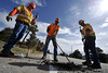 Walt Hester | Trail Gazette<br /> Colorado Department of Transportation crew of Owen Marshall, Eric Minde and Jim May patch a hole in South St. Vrain Avenue on Tuesday. The road crew was taking advantage of a short window of dry weather.