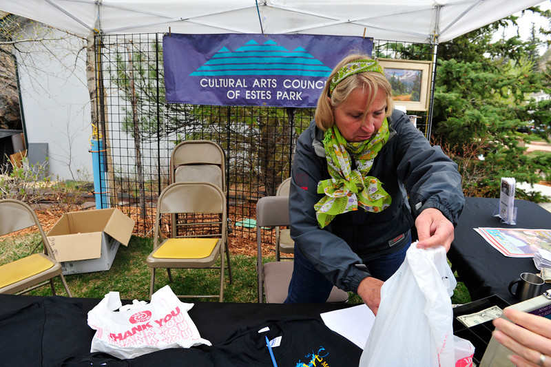 Walt Hester | Trail Gazette<br /> Lynda Vogel of the Cultural Arts Council bags a t-shirt at the Jazz Fest on Saturday. The CAC promoted the Spring Gallery and Art Walk, coinciding with the Jazz Fest.