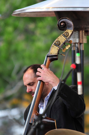 Walt Hester | Trail Gazette<br /> An overhead heater warms the head and instrument of bassist Mark Simon on Sunday. Temperatures never got above the mid-40s for the weekend, but it was not enough to keep jazz fans from the annual Estes Park Jazz Festival.