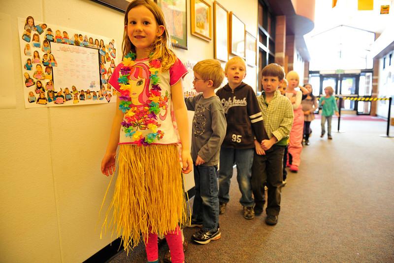 Walt Hester | Trail Gazette<br /> Anna Roberts, 6, sports Hawaiian fashion at the Estes Park Elementary School on Wednesday. Children were encouraged to wear Hawaiian clothing on Wednesday.