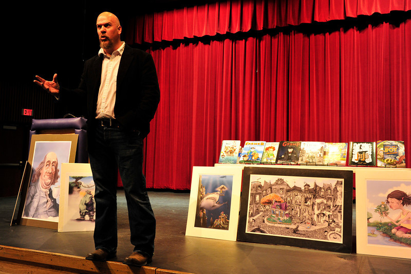 Walt Hester<br /> Autor and illustrator Mark Ludy of Windsor, Colo., shows his enthusiasm for his art to middle and high school students at the Estes Park High School auditorium on Friday. Ludy had spoken to the elementary school earlier in the day.