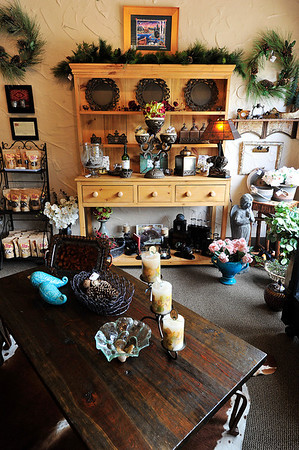 Walt Hester | Trail Gazette<br /> Country cabin furnature and accents fill Life's Bear Necessities on Park Lane on Wednesday. The new Estes Park business enjoyed its grand opening last week