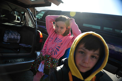 Walt Hester | Trail Gazette Abbie, left, and Gabe Housewrite prepare for school in the Estes Park Elementary School parking lot on Tuesday. This is the last week of school for Estes Park students.