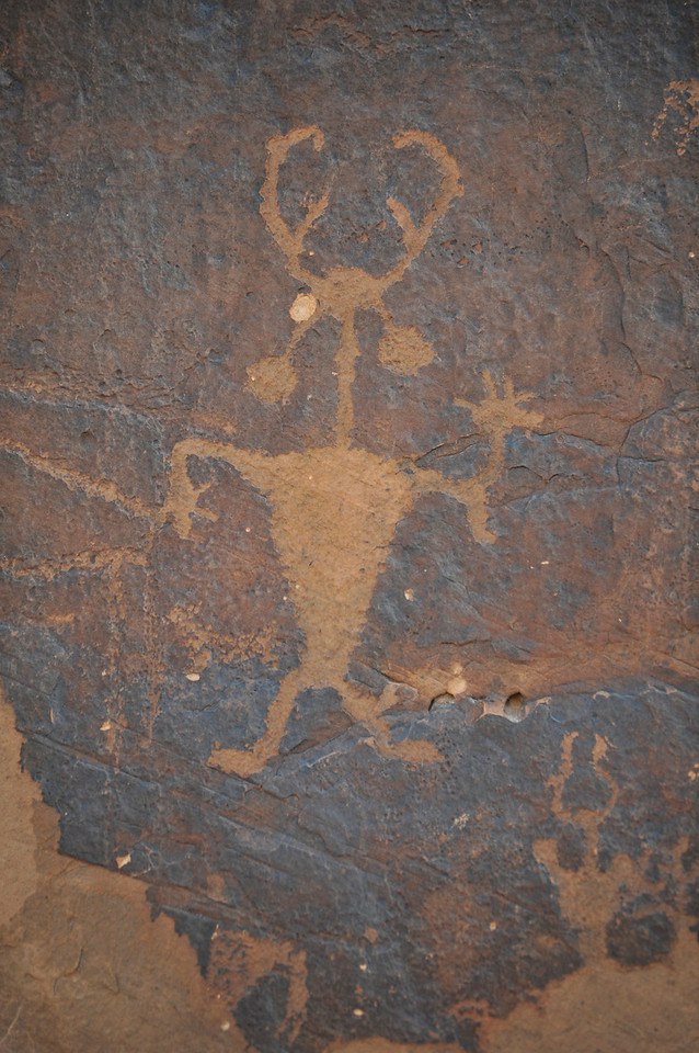 Walt Hester | Trail Gazette<br /> An eerie figure waves through time to visitors of Moab's golf club. Several native tribes moved in and out of the Canyonlands of Utah over the centuries, many leaving these clues to their lives and cultures.