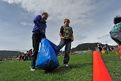 Walt Hester | Trail Gazette Third-graders Paulina Tapia and Ashton Long reach the turn around point of their three-legged race on Wednesday. The Estes Park Elementary School held it's annual Field Day this week, ushering in the end of the school year.