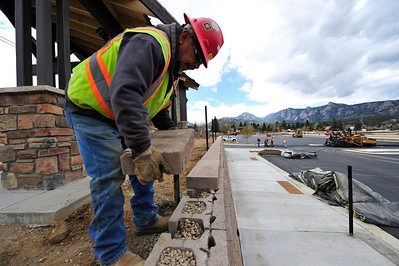 Walt Hester | Trail Gazette Moses Ramos of Coulson Excavating lays a block on top of a retaining wall at the Stanley Park Transit Hub on Wednesday. The hub should be complete by mid-June.