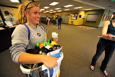 Walt Hester | Trail Gazette Graduating senior Kyra Stark heads out the door one last time on Wednesday with one of three piles of items from her locker. The Class of 2011 graduates on Friday with ceremonies at the YMCA of the Rockies.