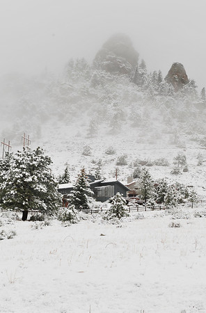 Walt Hester | Trail Gazette<br /> Snow and clouds obscure the top of Prospect Mountain on Thursday. Clearing skys should be the norm after Wednesday in Estes Park.
