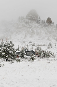 Walt Hester | Trail Gazette Snow and clouds obscure the top of Prospect Mountain on Thursday. Clearing skys should be the norm after Wednesday in Estes Park.