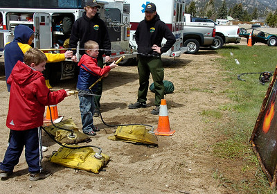 Youthful particpants take aim with fire suppression equipment Saturday during the police department's annual safety fair.