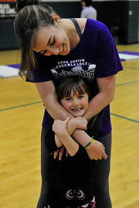 Walt Hester | Trail Gazette Estes Park High School cheerleader Maira Rodrigues hugs Maya Kiser at the elementary school on Thursday, May 19. The high school's cheerleaders were at the elementary school to conduct a clinic for the younger children.