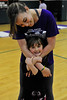 Walt Hester | Trail Gazette<br /> Estes Park High School cheerleader Maira Rodrigues hugs Maya Kiser at the elementary school on Thursday, May 19. The high school's cheerleaders were at the elementary school to conduct a clinic for the younger children.