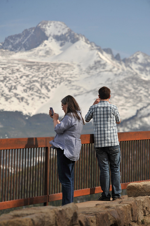 Walt Hester | Trail Gazette<br /> Susan Flanagan of Wilton, Conn., and Brendan Flanagan of Boulder photograph the the natural beauty from Many Parks Curve on Tuesday. Officials hope to open the highest stretch of Trail Ridge Road by this weekend.