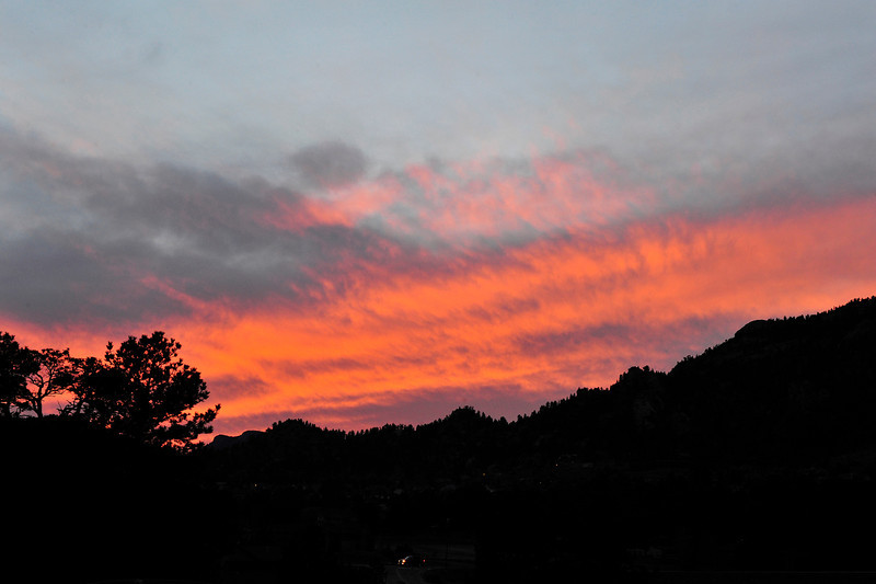 Walt Hester | Trail Gazette<br /> Tuesday's sunset spreads, than fades across the western sky. A mix of sun and clouds are expected for the weekend in Estes Park.