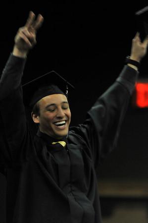 Walt Hester | Trail Gazette<br /> A jubilant Bridger Baird salutes the assembled friends, family and fellow class memebers at graduation ceremonies on Friday.