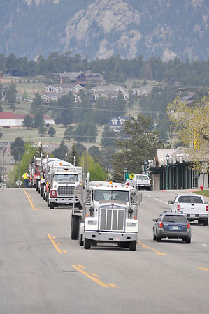 Walt Hester   Trail Gazette<br /> Trucks line up on South St. Vrain Avenue on Wednesday with asphalt for paving on Manford Avenue. The new paving on the street should complement the newly paved lot at the Stanley Fair Grounds.