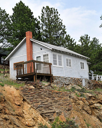 Walt Hester | Trail Gazette<br /> An older home perches above Big Horn Drive on Wednesday. Many of the 50 year old, or older homes could be effected by a proposed town ordinance.