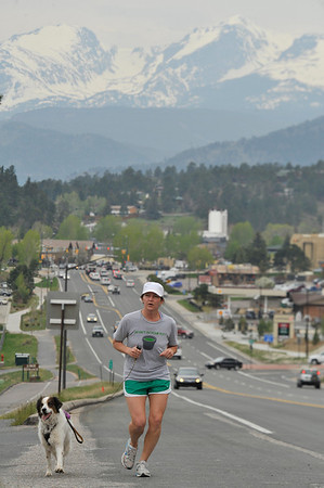 Walt Hester | Trail Gazette<br /> Sabrina Robin climbs Big Thompson Avenue on Wednesday with her training partner, Marley. The pair inadvertently enjoyed National Running Day, a celebration of the simplest way to stay fit.